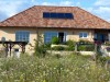 Einfamilienhaus im Bungalowstil mit großen Sprossenfenstern