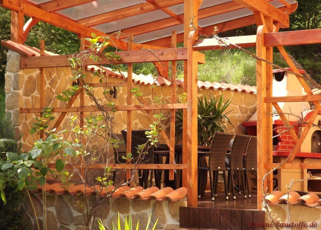 Überdachte Terrasse mit Riemchenmauer