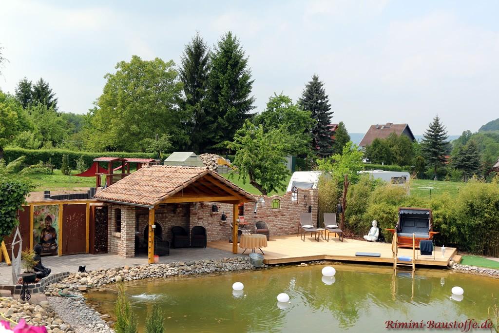 Gartenhaus am eigenen Teich mit Terrasse über dem See