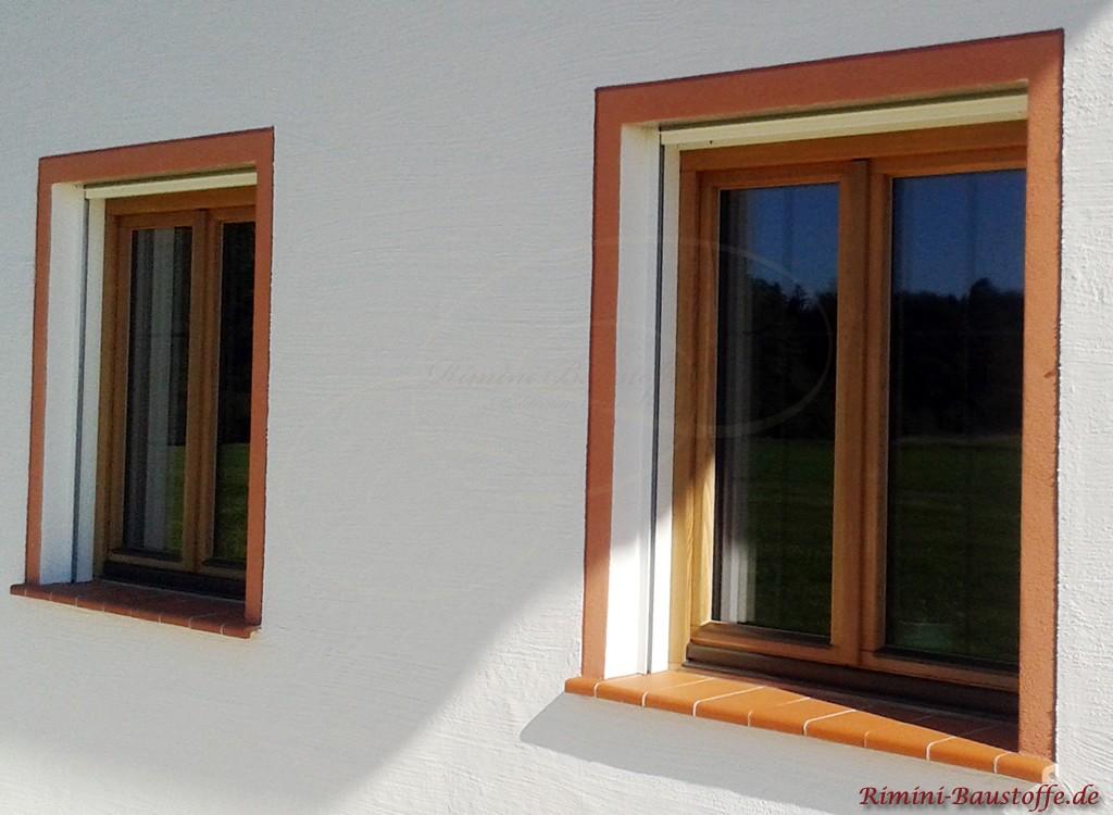 rote Tonfensterbank mit farblich passender Farbfasche