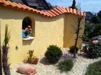 Mauerabdeckungen - Objektbild Gartenmauer mit Coppo di Domenica bedeckt