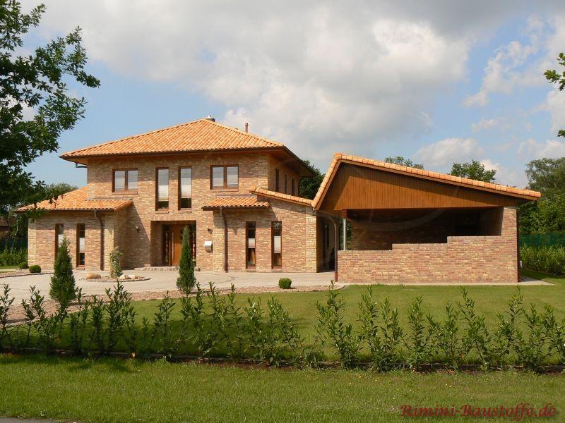 Einfamilienhaus im Norden mit Klinkerfassade und schönen passenden Dachziegeln im südländischen Stil