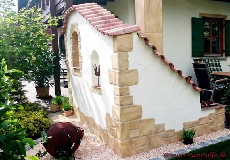Gartenmauer mit Halbschalen gedeckt und mit Highlights in Natursteinoptik